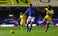 Oldham Athletic's Craig Davies under pressure from AFC Wimbledon's Adedeji Oshilaja during the Sky Bet League 1 match between Oldham Athletic and AFC Wimbledon at Boundary Park, Oldham, England on 21 November 2017. Photo by Juel Miah/PRiME Media Images