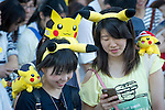 Two cheerful Pokomen fans at the Pikachu Parade on August 7, 2016 held during the weeklong Pikachu Breakout event in the Japanese port town of Yokohama, nearby Tokyo.<br /> <br /> Photo by DUITS/AFLO