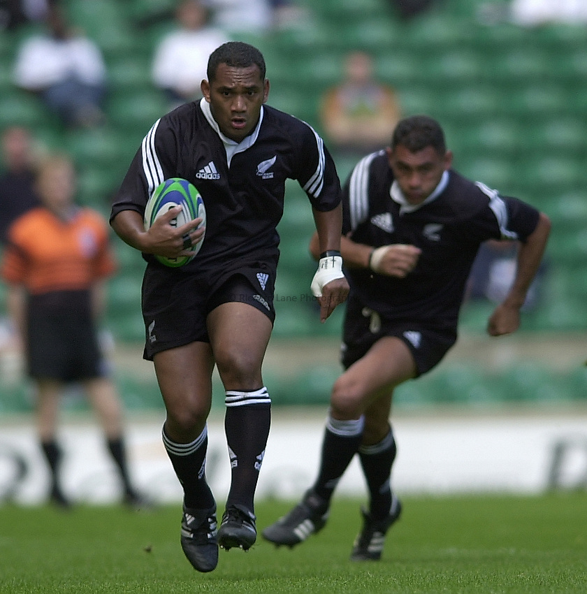 Photo Peter Spurrier.24/05/2002 (Friday).Sport -Rugby Union - London Sevens.New Zealand vs Georgia.Amasio Valence, running with ball, supporteds by Eric Rush.