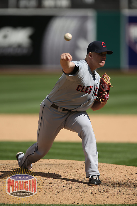 OAKLAND, CA - APRIL 2:  Vinnie Pestano #52 of the Cleveland Indians pitches against the Oakland Athletics during the game at O.co Coliseum on Wednesday, April 2, 2014 in Oakland, California. Photo by Brad Mangin