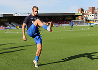 James Hanson of AFC Wimbledon warms up ahead of kick-off during AFC Wimbledon vs Portsmouth, Sky Bet EFL League 1 Football at the Cherry Red Records Stadium on 13th October 2018