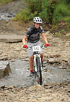 NWA Democrat-Gazette/ANDY SHUPE<br /> Cason Pool of Pineville, Mo., rides across Lee Creek Saturday, Sept. 19, 2015, during the Northwest Arkansas Mountain Bike Championships at Devil's Den State park.