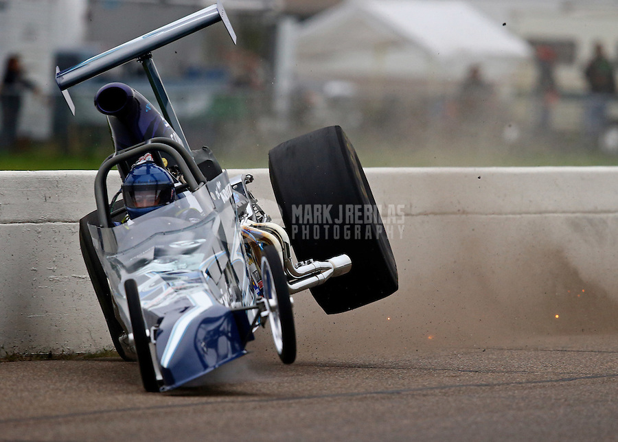 Aug 17, 2014; Brainerd, MN, USA; NHRA top dragster driver Don Kritzky hits the wall and crashes during the semi finals of the Lucas Oil Nationals at Brainerd International Raceway. Mandatory Credit: Mark J. Rebilas-USA TODAY Sports