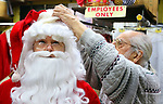 WATERBURY CT. 22 December 2017-122217SV02-Mike Patrick, Republican American, sees what it feels like to transform into Santa at Arabesque on Bank Street in Waterbury Friday. Michael Rinaldi, owner, right, dressed Mike.<br /> Steven Valenti Republican-American