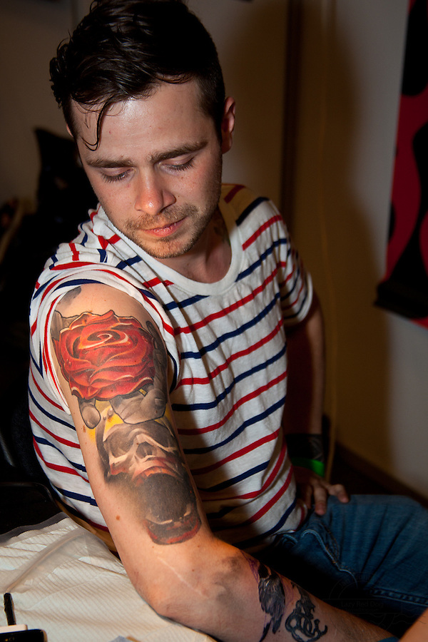 Copenhagen Inkfestival 2012. Rose and skull tattoo on shoulder in color.
