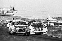 #95 Renault R12 of  Ned Skiff, Jim Leo (38th place) and #09 Porsche 936L of Derek Bell, Michael Andretti, John Paul Jr., 57th place, 12 Hours or Sebring, Sebring International Raceway, Sebring, FL, March 19, 1983.  (Photo by Brian Cleary/bcpix.com)