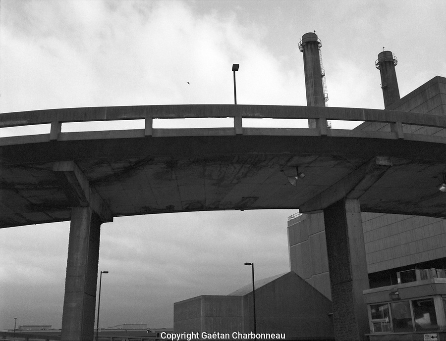 Elevetade concrete road, grey sky behind