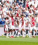 Nederland, Amsterdam, 30 maart 2014<br /> Eredivisie<br /> Seizoen 2013-2014<br /> Ajax-FC Twente<br /> Stefano Denswil (2e van l.) van Ajax viert zijn doelpunt, de 1-0, met zijn ploeggenoten.
