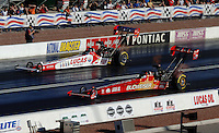 Apr 7, 2006; Las Vegas, NV, USA; NHRA Top Fuel driver Morgan Lucas in the Lucas Oil dragster races Brandon Bernstein in the Budweiser dragster during qualifying for the Summitracing.com Nationals at Las Vegas Motor Speedway in Las Vegas, NV. Mandatory Credit: Mark J. Rebilas