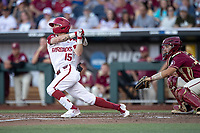 Arkansas Razorbacks shortstop Casey Martin (15) follows through on his swing during Game 2 of the NCAA College World Series against the Florida State Seminoles on June 15, 2019 at TD Ameritrade Park in Omaha, Nebraska. Florida State defeated Arkansas 1-0. (Andrew Woolley/Four Seam Images)