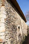 Exterior wall of Saint James chapel, Lindsey, Suffolk, England, UK