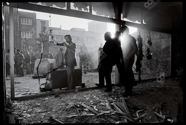 Crowds examine the torture apparatus in a house formerly used by SAVAK. Tehran, December 31, 1978