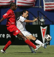 July 24, 2005: East Rutherford, NJ, USA:  USMNT midfielder Landon  Donovan (10) crosses the ball away from Panama's Carlos Rivera (2) during the CONCACAF Gold Cup Finals at Giants Stadium.