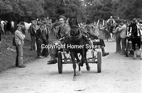 Appleby in Westmorland Horse fair Cumbria. 1981 Showing a horse gypsy men racing down the road shouting to bystanders to move out of the way.