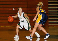 Senior Katie Hilbelink of Point Loma Nazarene University moves past Heather Witt of  UW Eau Claire during the 2007 Surf N Slam Women?s Basketball Tournament at Golden Gymnasium on the PLNU campus in San Diego, Saturday December 29 2007.   Hilbelink and fellow senior Kerra Sutton-Wodarski contributed 13 points each to the Sea Lions  71 - 51 victory over Eau Claire that secured fourth place overall in the Surf N Slam.  Hilbelink was selected for the all-tournament team.  PLNU played host to the tournament December 27, 28 and 29.  The eight team field included seven NCAA DIII schools; UW Stevens Point, UW Eau Claire, Carroll (WI), Gustavus Adolphus (MN), Ithaca (NY), Maryville (MO), Rivier (NH). Point Loma was the only NAIA school competing.  The tournament was won by Maryville who defeated Gustavus Aldolphus 68-64 in the final game on Saturday.