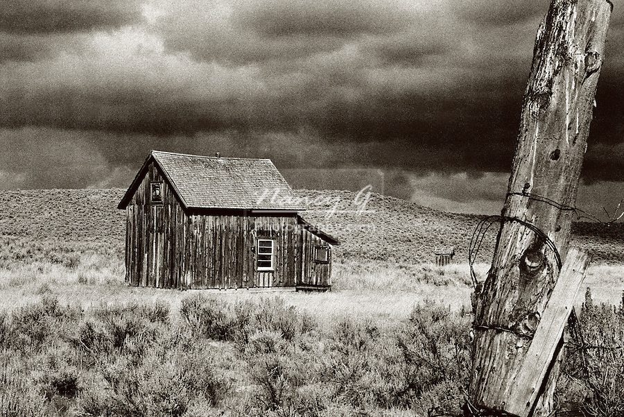 Historical cabin and outhouse on homestead in the high desert of Central Oregon