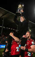 Wyatt Crockett on the shoulders of Luke Romano and Kieran Read of the Crusaders with the trophy following the 2018 Super Rugby final between the Crusaders and Lions at AMI Stadium in Christchurch, New Zealand on Sunday, 29 July 2018. Photo: Joe Johnson / lintottphoto.co.nz