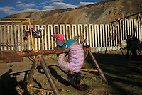 Children play in a playground bordering contaminated mine tailings in the Paragsha neighborhood of Cerro de Pasco, Peru.