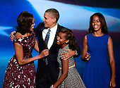 United States President Barack Obama and his family on the podium following his acceptance speech at the 2012 Democratic National Convention in Charlotte, North Carolina on Thursday, September 6, 2012.  From left to right: First lady Michelle Obama, President Obama, Sasha Obama, and Malia Obama.  .Credit: Ron Sachs / CNP.(RESTRICTION: NO New York or New Jersey Newspapers or newspapers within a 75 mile radius of New York City)