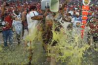 Hillsborough, Tampa, Fl. 12/6/2008 -ACC BOSTON VT-    Virginia Tech head coach Frank Beamer is doused by cornerback Victor Harris #1 and wide receiver Cory Holt #12 after beating Boston College in the 2008 ACC Football Championship Game at Raymond James Stadium  Saturday, December 6, 2008 in Tampa, Florida.  PHOTOS 15 of  IMAGES STAFF MICHAEL SPOONEYBARGER..
