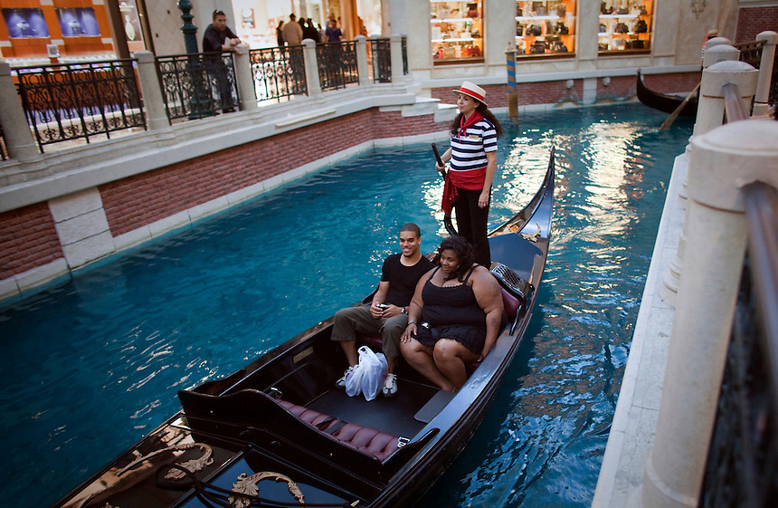 A couple are transported on a gondola in the Venetian Hotel and Casino in Las Vegas.