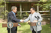 United States President George W. Bush and President Hosni Mubarak of Egypt shake hands after answering reporters questions on the Middle East at Camp David, Maryland  on Saturday, June 8, 2002..Credit: Greg E. Mathieson - Pool via CNP