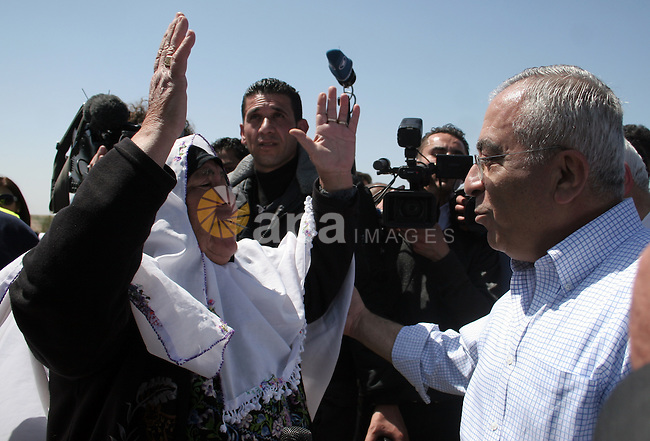 "Palestinian prime minister Salam Fayyad during his visits in the southern town of Yatta, near Hebron in the occupied West Bank, on March 30, 2011, as hundreds of people across Israel and Palestinian territories were holding a series of rallies marking ""Land Day,"" recalling an incident in 1976 when Israeli troops shot and killed six people during protests against land confiscations .Photo by Najeh Hahlamoun"