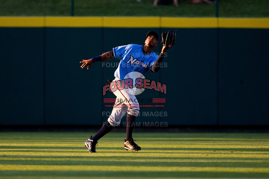 Yem Prades (19) of the Northwest Arkansas Naturals attempts to catch a fly ball in center field during a game against the Springfield Cardinals at Hammons Field on June 14, 2012 in Springfield, Missouri. (David Welker/Four Seam Images)