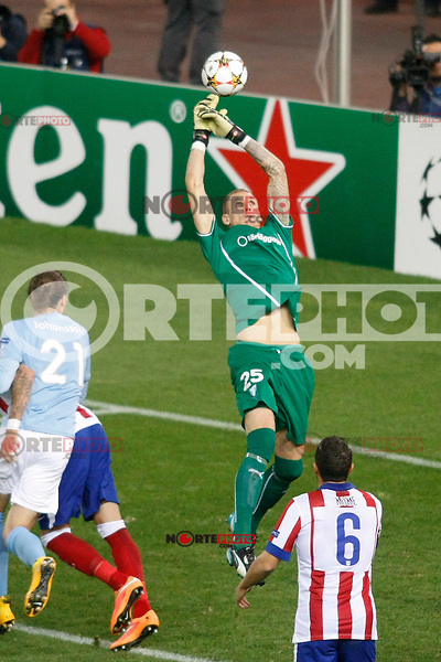 Atletico de Madrid´s Koke (D) and Malmo´s goalkeeper Olsen during Champions League soccer match between Atletico de Madrid and Malmo at Vicente Calderon stadium in Madrid, Spain. October 22, 2014. (ALTERPHOTOS/Victor Blanco)