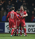 Sean Canham of Kidderminster (on loan from Hereford) (2nd right) is mobbed by team-mates after scoring the first goal during the Blue Square Bet Premier match between Cambridge United and Kidderminster Harriers at the Abbey Stadium, Cambridge on 18th February, 2011 .© Kevin Coleman 2011.