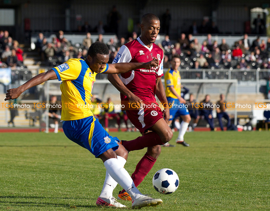 Osei Sankofa of Eastleigh clears under pressure from Donovan Simmonds of Chelmsford City  - Chelmsford City vs Eastleigh - Blue Square Conference Football at Melbourne Park, Chelmsford, Essex - 13/10/12 - MANDATORY CREDIT: Ray Lawrence/TGSPHOTO - Self billing applies where appropriate - 0845 094 6026 - contact@tgsphoto.co.uk - NO UNPAID USE.