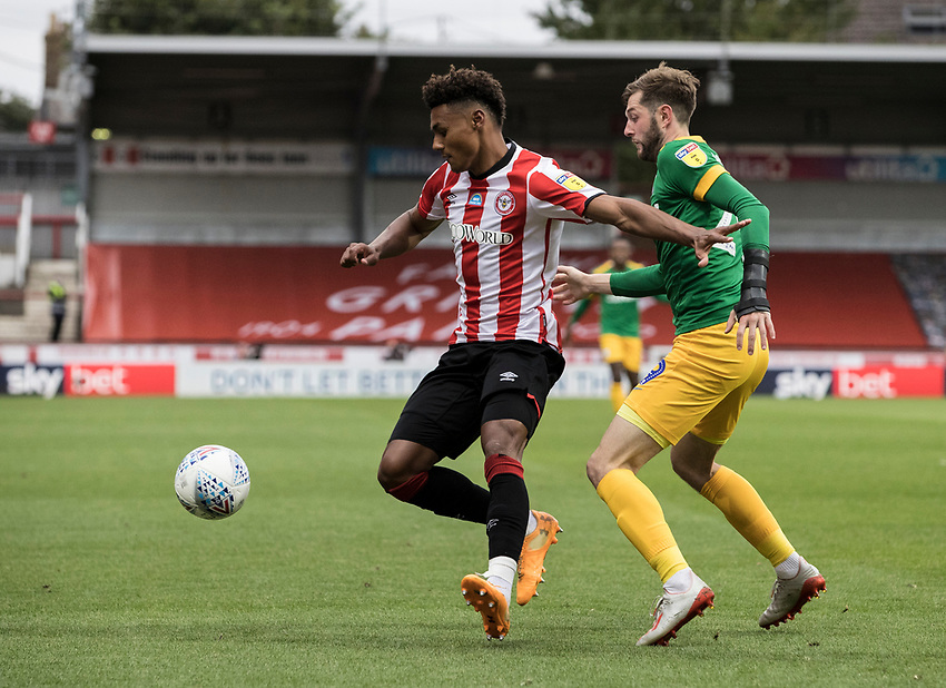 Preston North End's Tom Barkhuizen competing with Brentford's Ollie Watkins (right) <br /> <br /> Photographer Andrew Kearns/CameraSport<br /> <br /> The EFL Sky Bet Championship - Brentford v Preston North End - Wednesday 15th July 2020 - Griffin Park - Brentford <br /> <br /> World Copyright © 2020 CameraSport. All rights reserved. 43 Linden Ave. Countesthorpe. Leicester. England. LE8 5PG - Tel: +44 (0) 116 277 4147 - admin@camerasport.com - www.camerasport.com