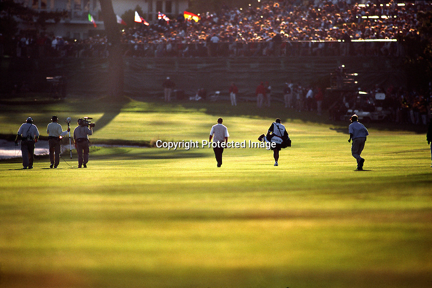 Tiger Woods walks towards the 18th green and into a multitude of fans at the conclusion of his thrird round of the 2000 US OPEN Golf at Pebble Beach