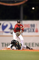 Nashville Sounds second baseman Hainley Statia (16) attempts to turn a double play as Paulo Orlando (16) slides in during the second game of a double header against the Omaha Storm Chasers on May 21, 2014 at Herschel Greer Stadium in Nashville, Tennessee.  Nashville defeated Omaha 13-4.  (Mike Janes/Four Seam Images)