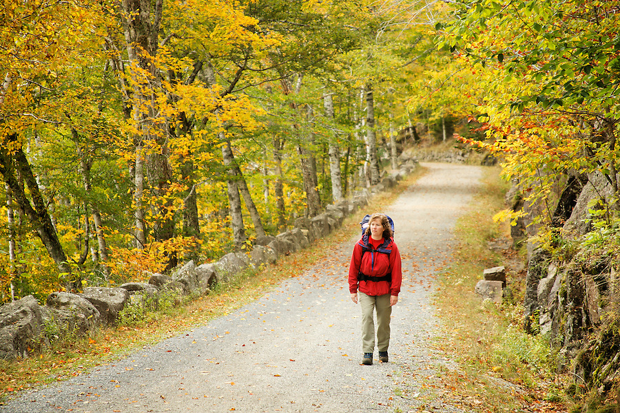 Woman walking carriage road, Acadia National Park, Hancock County, Maine, USA