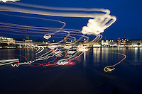 Abstract.The Rathaus and buildings at night time on the lake Binnenalster Hamburg, Germany