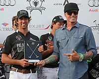 WELLINGTON, FL - APRIL 15:  Robert Van Winkle presents Palm Beach Illustrated's Agustin Obregon with the Most Valuable Player Award.  Palm Beach Illustrated defeats Valiente I, 13-7 in the $100,000 World Cup Final, at the Grand Champions Polo Club, on April 15, 2017 in Wellington, Florida. (Photo by Liz Lamont/Eclipse Sportswire/Getty Images)