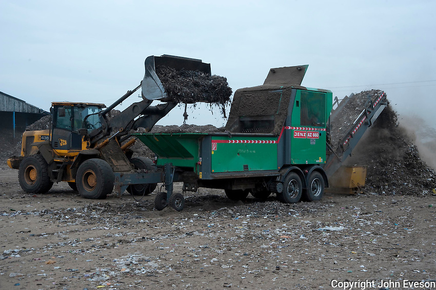 Screening green waste for composting, Doncaster, Yorkshire.