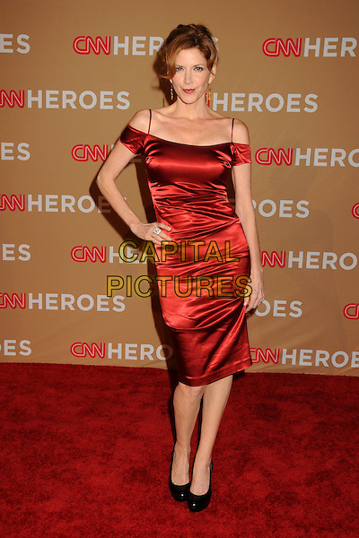MELINDA McGRAW.CNN Heroes: An All-Star Tribute 2010 held at the Shrine Auditorium, Los Angeles, California, USA, .20th November 2010..full length dress hand on hip  red silk satin straps cut out shoulders black shoes .CAP/ADM/BP.©Byron Purvis/AdMedia/Capital Pictures.
