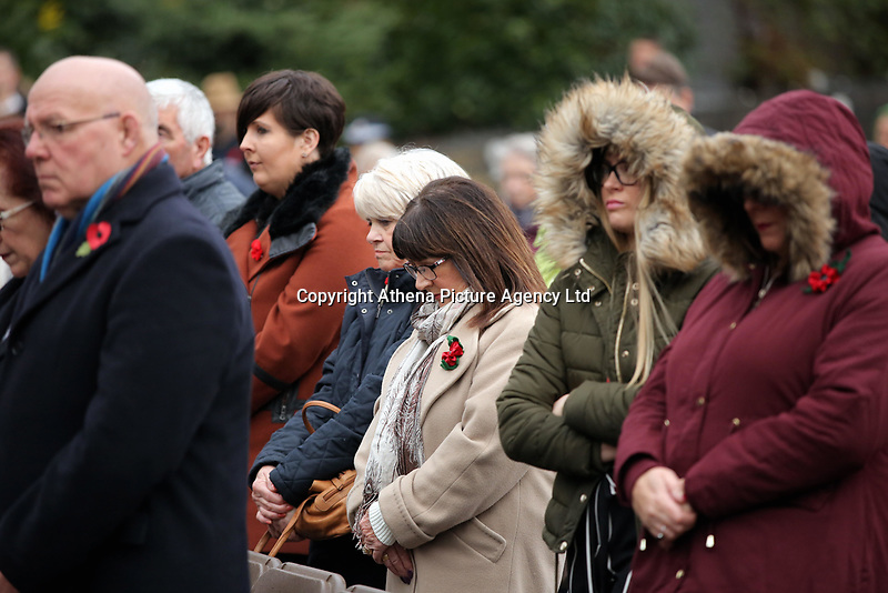 Pictured: People observe the two minute silence. Saturday 11 November 2017<br />Re: Armistice Day, two minutes were observed to mark remembrance at Castle Square in Swansea, Wales, UK.