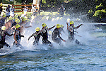 A wave of triathletes begin their swim at the Chelanman Multi-Sport weekend in Chelan.