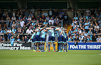 Wycombe pre match team huddle during the Sky Bet League 2 match between Wycombe Wanderers and Colchester United at Adams Park, High Wycombe, England on 27 August 2016. Photo by Andy Rowland.