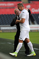 Manager Brian Flynn hugs Lee Trundle while coming off the pitch. during the Swansea Legends v Manchester United Legends at The Liberty Stadium, Swansea, Wales, UK. Wednesday 09 August 2017