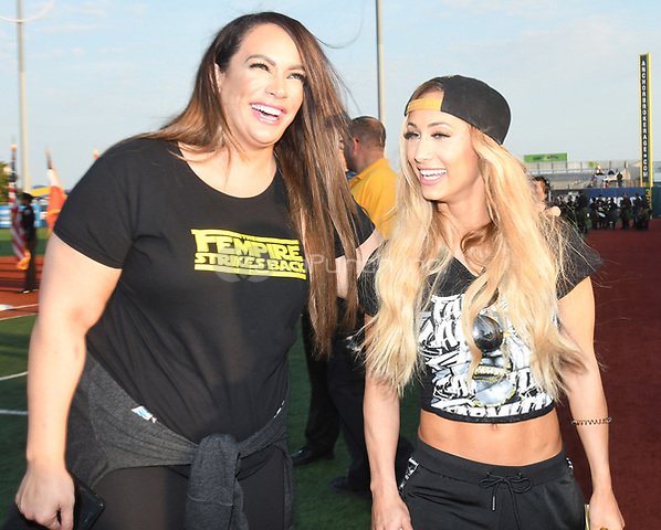 Brooklyn, NY - AUGUST 17: WWE Superstars Nia Jax and Carmella visits MCU Park in Brooklyn, New York on August 17, 2017 during Summer Slam Week. Photo Credit: George Napolitano/MediaPunch
