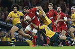 Captain Sam Warburton drives Wales forward despite the eftorts of Australian outside half Bernard Foley to stop him.<br /> Dove Men Series 2014<br /> Wales v Australia<br /> Millennium Stadium<br /> 08.11.14<br /> ©Steve Pope-SPORTINGWALES