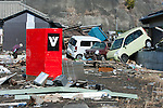 Mar. 13, 2011 - Kita-Ibaraki, Japan - Vehicles are shown piled up into houses two days after the 8.9 magnitude earthquake struck followed by a tsunami that hit the north-eastern region. The death toll is currently unknown with casualties that may run well into the thousands.