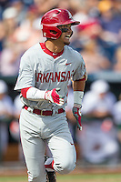 Arkansas Razorbacks second baseman Rick Nomura (1) runs to first base during the NCAA College baseball World Series against the Miami Hurricanes on June 15, 2015 at TD Ameritrade Park in Omaha, Nebraska. Miami beat Arkansas 4-3. (Andrew Woolley/Four Seam Images)
