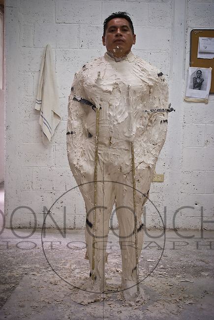 Waiting for the mold to set, a mayan man stands as still as possible. His likness is to be part of the Underwater Sculpture Museum in Cancun, Mexico by Artist Jason deCaiires Taylor, a sculptor from London, England.