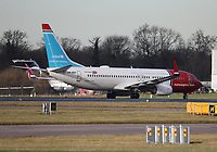 A Norwegian Boeing 737-8JP Registration LN-NGE in Unicef livery at Manchester Airport on 11.2.19 arriving from Stavanger Sola Airport, Norway.