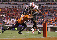 Nov 13, 2010; Charlottesville, VA, USA;  Maryland Terrapins wide receiver Torrey Smith (82) is tackled by Virginia Cavaliers cornerback Chase Minnifield (13) during the 2nd half of the game at Scott Stadium. Maryland won 42-23. Mandatory Credit: Andrew Shurtleff